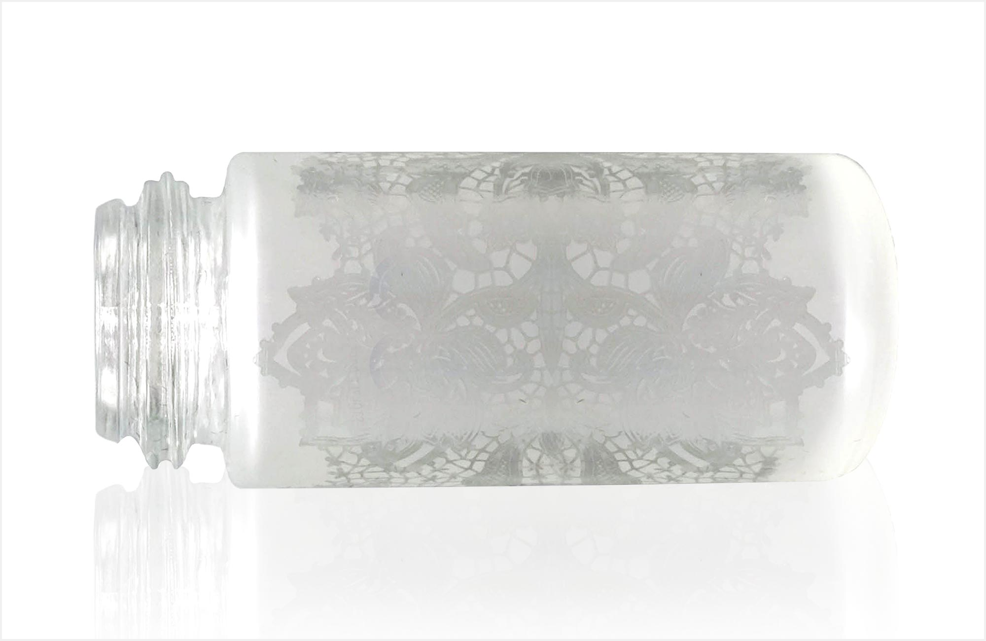 Sample of glass bottle decorated with masked frosting