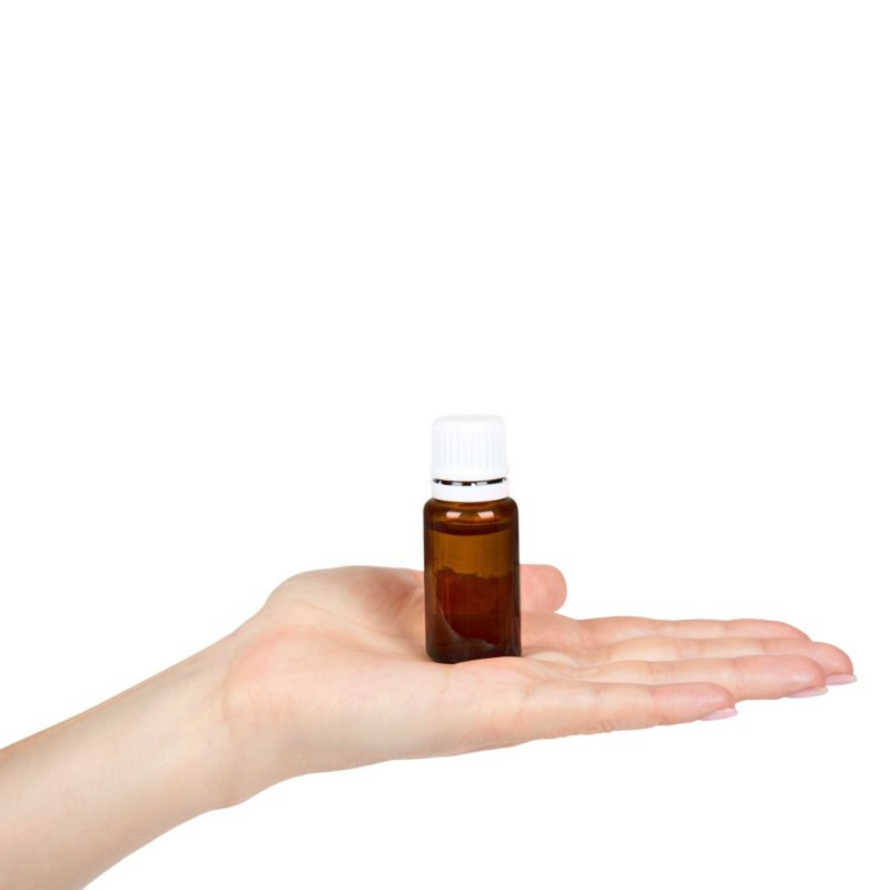 Picture of a hand holding an amber bottle