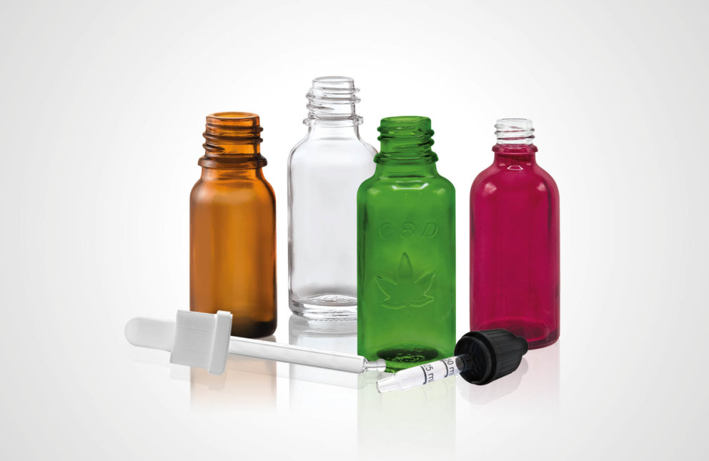 Dropper bottles, also with an embossed hemp leaf, and closures